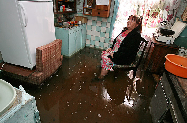 Melting snow in mountainous districts has caused flooding in the village of Zaton in Russia.