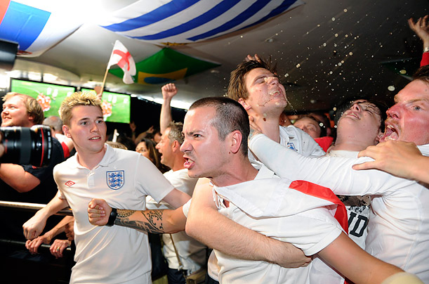English fans react in a London bar at the end of the England vs. Slovenia World Cup match.