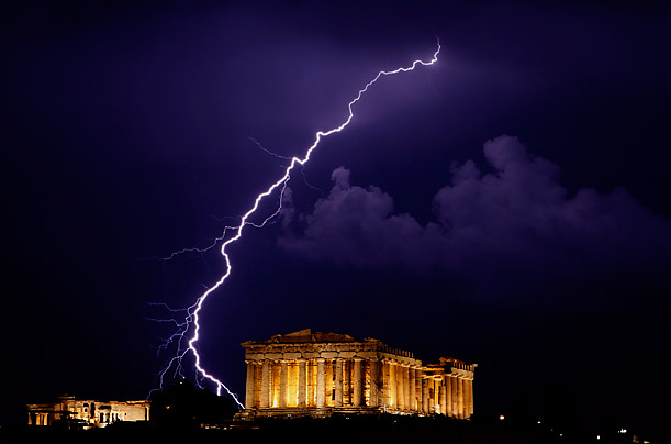 A Bolt of lighting streaks across the sky over the Parthenon in Athens, Greece.
