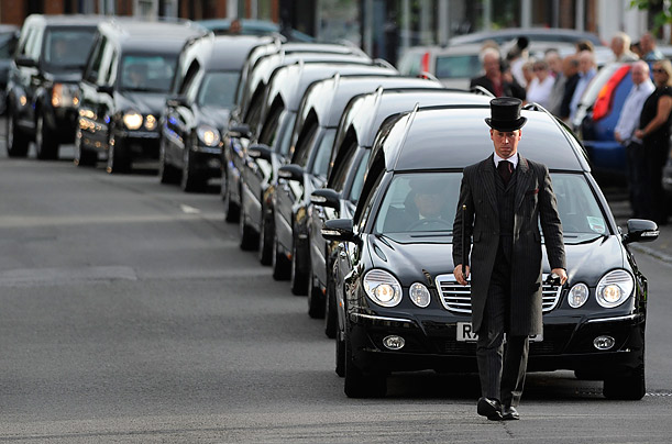 A repatriation cortege carrying seven fallen British soldiers passes through the town of Wootton Bassett, England.