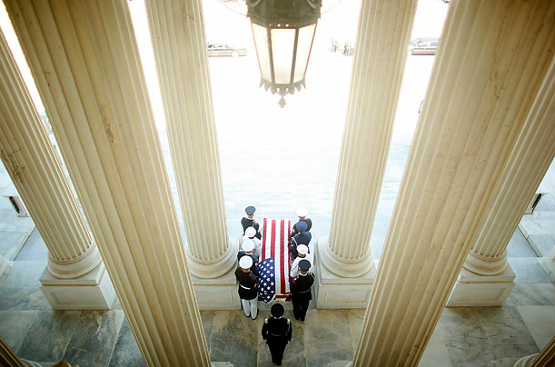 A U.S. Military District of Washington honor guard carries Sen. Robert Byrd's flag-draped casket out of the U.S. Capitol in Washington.
