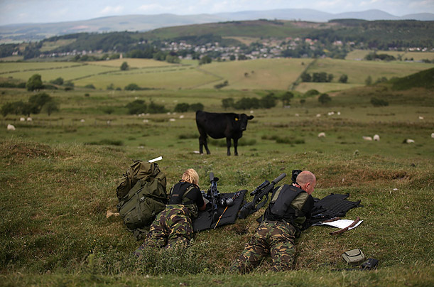 Police marksmen overlook the hills and moors near the village of Rothbury, England, as they search for the armed fugitive Rauol Moat. Moat went on the run after shooting three people, one fatally.