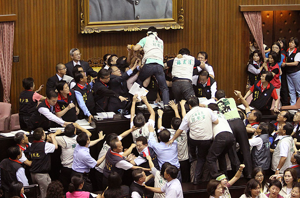 Lawmakers in Taipei brawl during discussions concerning the Economic Cooperation Framework Agreement (ECFA) planned with China.