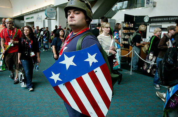 An attendee at Comic-Con International in San Diego shows off his Capt. America costume.