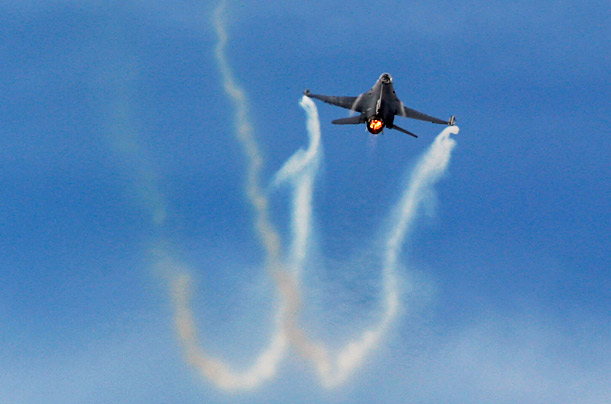 An F-16 flies during a display at the Farnborough International Air Show.