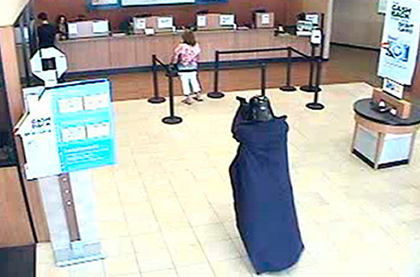 Opting for a gun rather than lightsaber, an unidentified man, disguised as Darth Vader robbed a Chase bank in Long Island and fled to a nearby parking lot.  The Sith lord made off with an undisclosed amount of cash.