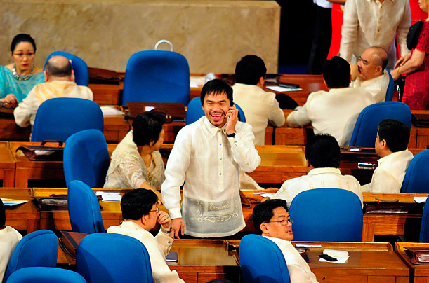 Boxer and politician Manny Pacquiao attends the first regular session of the Lower House of the Philippine Congress in Quezon City, Philippines.