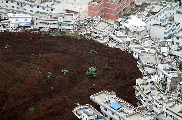 A rain-induced landslide hits the village of Shuanghe in China.