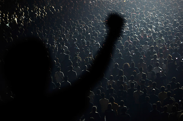 A concert goer is silhouetted during a performance by Slash, formerly of Guns N' Roses, during his show in Jakarta.