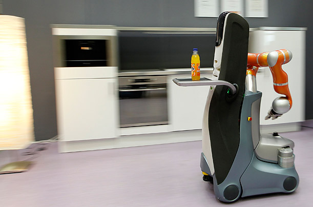 The Care-O-Bot III. a robot developed to help the elderly carries a drink through a kitchen at the Frauenhofer Institute in Stuttgart, Germany.