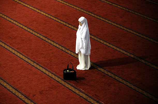 An Indonesian women prays during the first night of Ramadan in Jakarta, Indonesia.