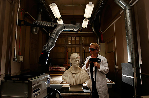 Conservationist Veronika Vlkova Antoniou of Birmingham Museum uses a laser gun to clean the bust of Cardinal Newman in Birmingham, England.