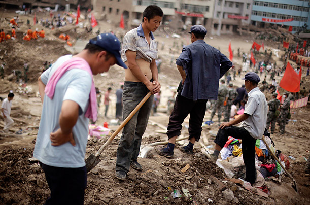 Residents rest from their search and rescue efforts in Zhouqu, China. A devastating mudslide triggered by heavy rainfall swept into the area killing more than 1,000.