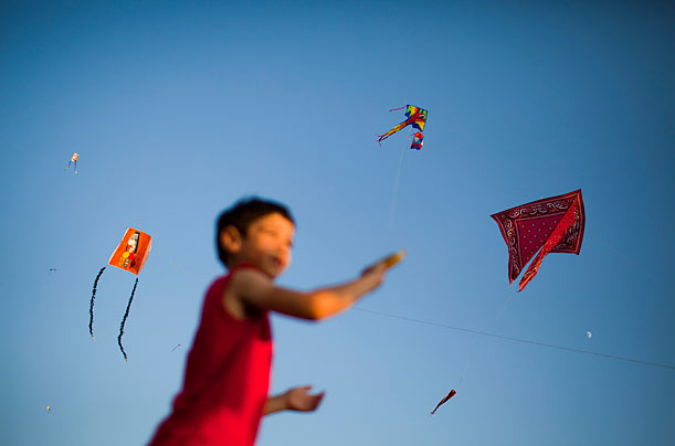 An Israeli child flies a kite during a kite festival in Jerusalem.