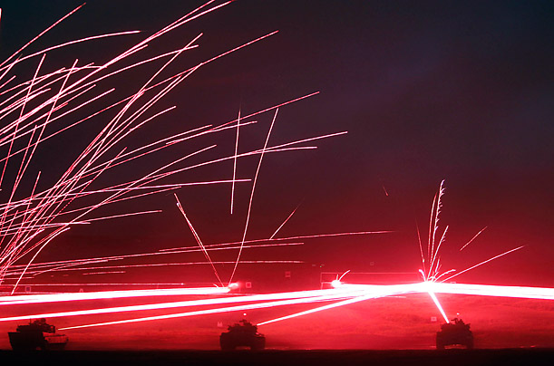 Japanese Ground Self-Defence Force armoured tanks fire their machine guns during a night session of annual training at Higashifuji training field near Mt. Fuji in Gotemba.