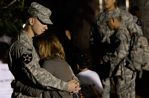 A U.S. soldier and his girlfriend are reunited at Joint Base Lewis-McChord in Washington.