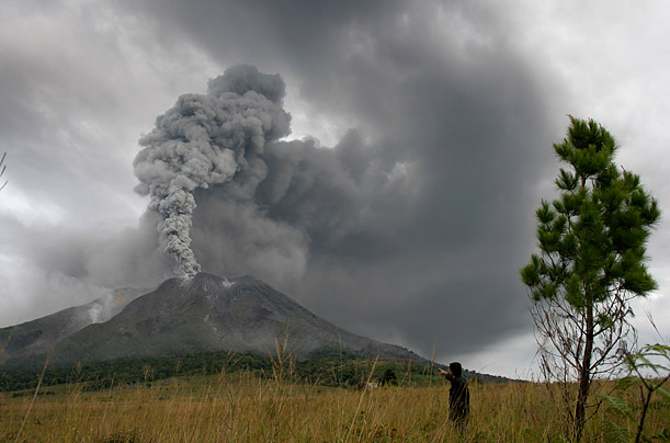 Mount Sinabung spews volcanic materials into the sky over Karo, North Sumatra, Indonesia.  This is the second day of eruption for the previously dormant volcano.
