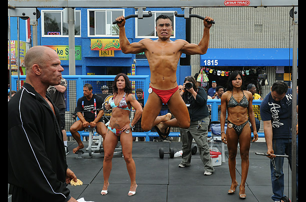 Bodybuilders prepare before an annual bodybuilding and bikini competition at Venice Beach, Calif.