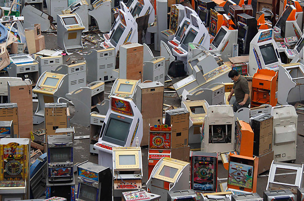 A worker arranges confiscated video game machines before destroying them in Jinan, Shandong province. Chinese police destroyed about 600 video game machines used for gambling as part of
