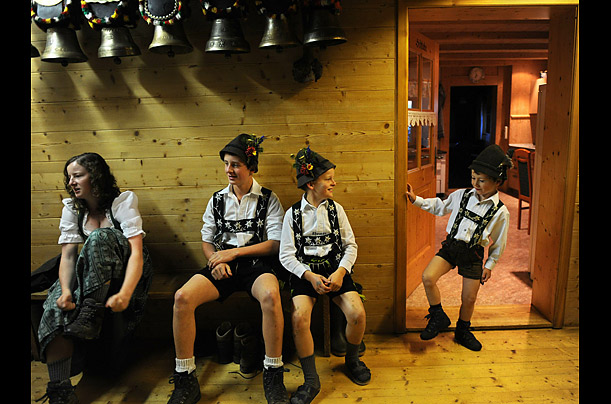 Children wear traditional Bavarian clothes as they prepare for the Allgaeuer Viehscheid cattle drive in southern Germany.  During the event, cow herds are brought down from their summer Alpine pastures to their stables in the valley.