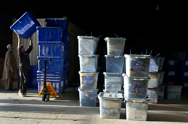 Workers unload ballot boxes at the Independent Election Commission warehouse in Kabul after the national elections for the lower house of parliment on September 19th, 2010.