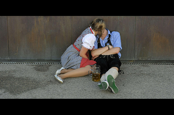 Festival goers kiss as they take a break from Oktoberfest at the Theresienwiese fairground in Munich.  Okotoberfest is the largest beer festival in the world and is celebrating its 200th anniversary.