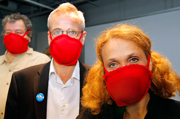 Dr. Elena Bodnar, John Durant, Director of the MIT Museum, and Gus Rancatore demonstrate bras that can be converted into gas masks at the MIT Museum in Cambridge, Massachusetts.