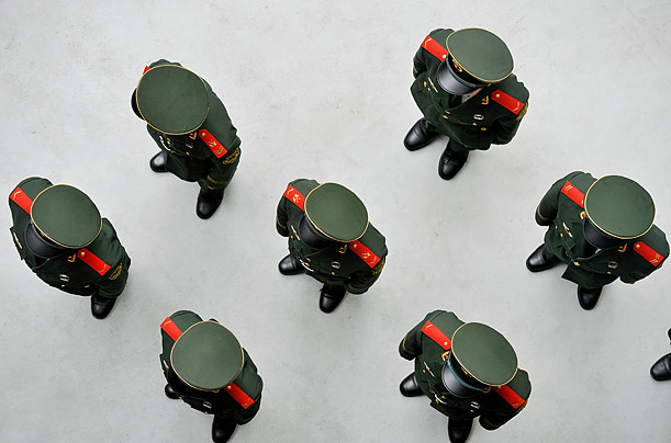 Chinese soldiers stand in line at the World Expo 2010 ahead of the China national pavilion day.