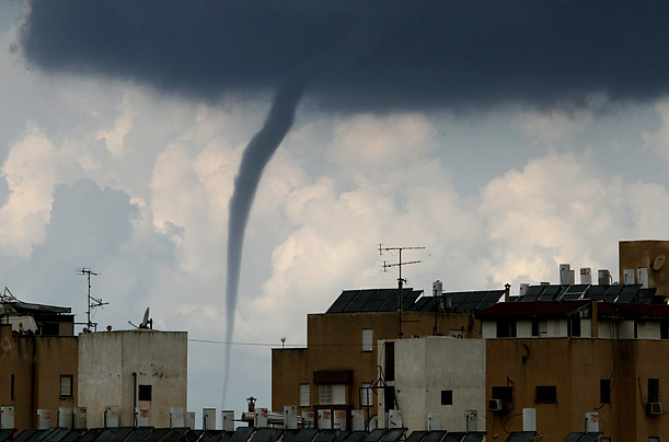 A water spout hits the coastal city of Netanya, north of Tel Aviv