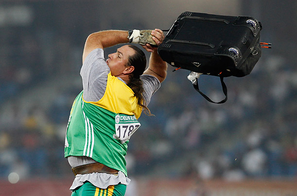 South Africa's Christiaan Harmse warms up before the Men's Hammer final during the Commonwealth Games at the Jawaharlal Nehru Stadium in New Delhi.
