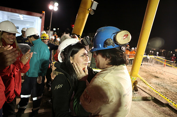 Chilean miner Osman Araya embraces his wife Angelica after being brought to the surface after a 10-week ordeal in the collapsed San Jose mine, near Copiapo, 800 km north of Santiago, Chile.