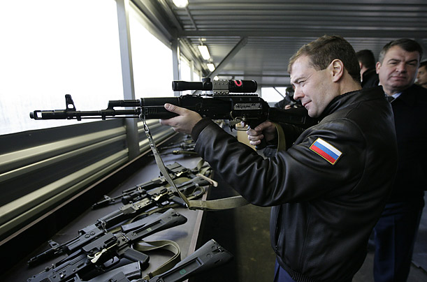Russian President Dmitri Medvedev aims a Kalashnikov rifle at a shooting range during a visit to a military unit in Solnechnogorsk.