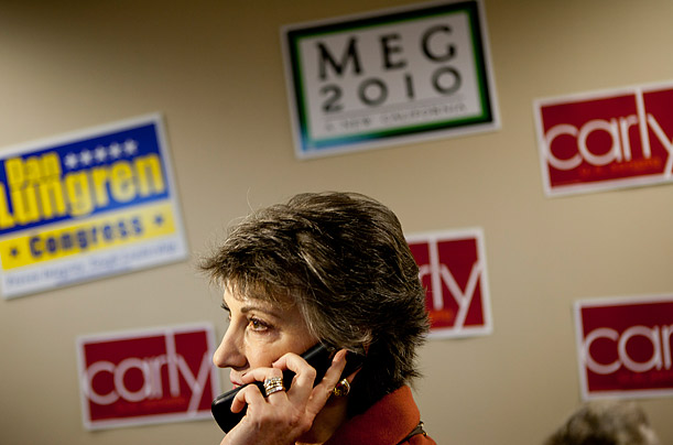 Republican senatorial candidate Carly Fiorina talks to voters on the phone at a GOP candidate phone bank in Elk Grove, California.