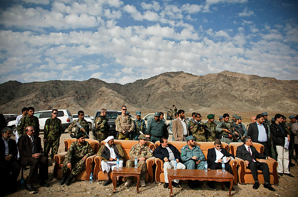 Military, government and security officials attend a buring of confiscated opium in Herat, Afghanistan. The opium was confiscated by security forces during recent anti-drug operations