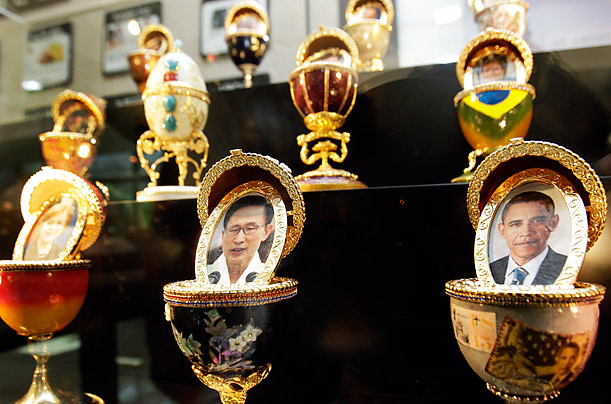 Pictures of U.S. President Barack Obama, right, South Korean President Lee Myung-bak, center, and other G20 Seoul Summit leaders are decorated on goose eggs at a shopping mall in Seoul, South Korea.