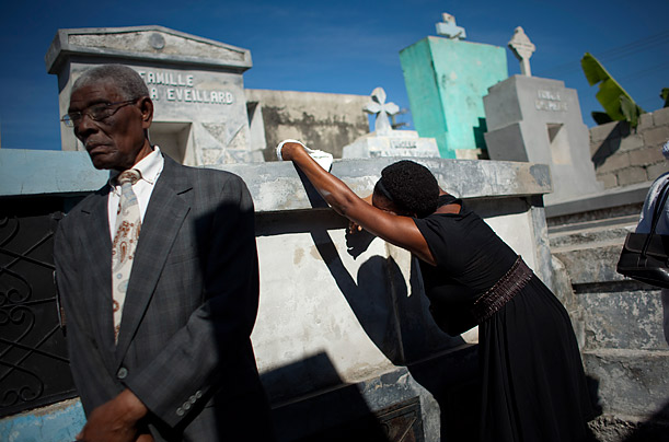 Relatives of Serge Ragmond, who died of cholera, mourn during his burial ceremony in Port-au-Prince, Haiti.