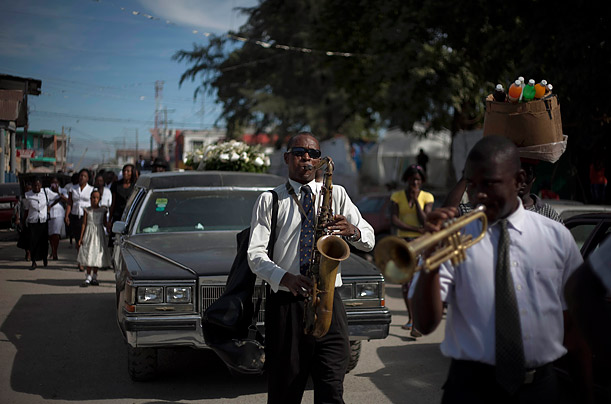 Musicians play in a funeral procession for a person who died of cholera in Port-au-Prince, Haiti.