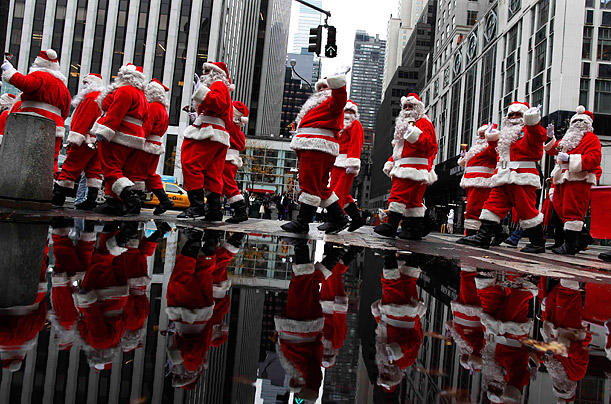 Volunteers from America's Sidewalk Santas kick off the holiday season walking through Midtown Manhattan during the 108th Annual Parade of Santas in New York.