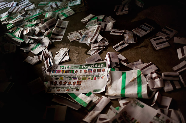 Election ballots lay scattered on the floor of a polling station in a village in Haiti.