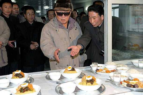 North Korean leader Kim Jong-II visits a dining hall at a light-industrial factory at Hamhung in South Hamhyong Provience.