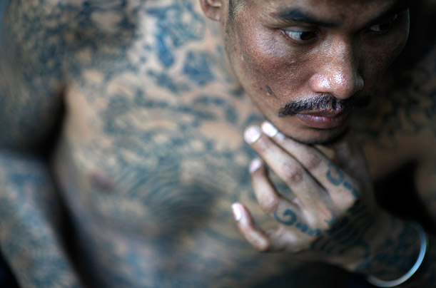Sontaya, a 39 year-old HIV positive Thai man rests at the Buddhist temple Wat Prabat Nampu in Lopburi.
