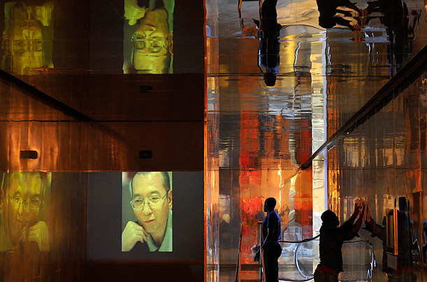 Workers prepare the Nobel Peace Prize laureate exhibition <span style='font-style: italic'>I have No Enemies</span> for Chinese dissident Liu Xiaobo at the Nobel Peace Center in Oslo, Norway.