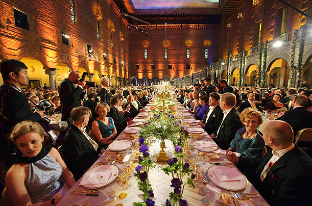 Guests dine at the Nobel banquet in the Stockholm Town Hall in Sweden after the presentation of the awards for achievements in physics, chemistry, physiology or medicine, and literature.