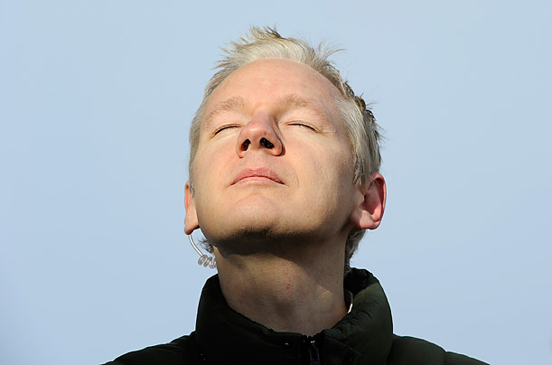 WikiLeaks founder Julian Assange pauses as he speaks to the media outside Ellingham Hall, in Norfolk, England.