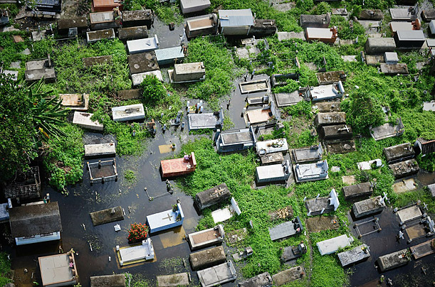 An Aerial view of a flooded cemetery in Barlovento, 150 Km northeast of Caracas. Torrential rains have killed at least 31 people in recent days as Venezuela grapples with its worst flooding in 40 years.