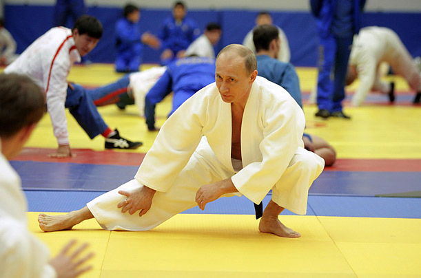 Russian Prime Minister Vladimir Putin stretches during a judo training session at a sports center in St. Petersburg, Russia.