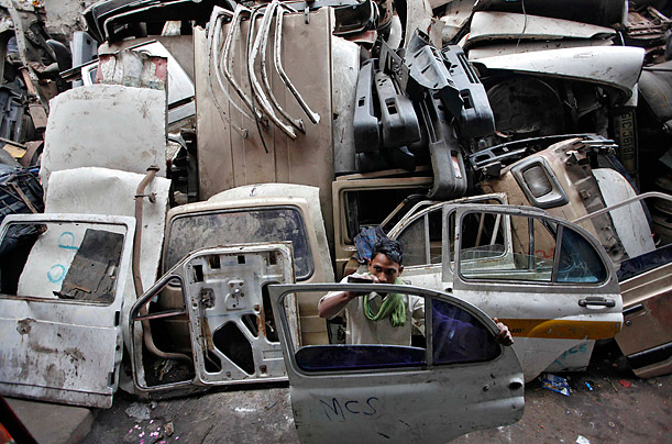 A man works inside a second-hand automobile parts market in Kolkata, India.