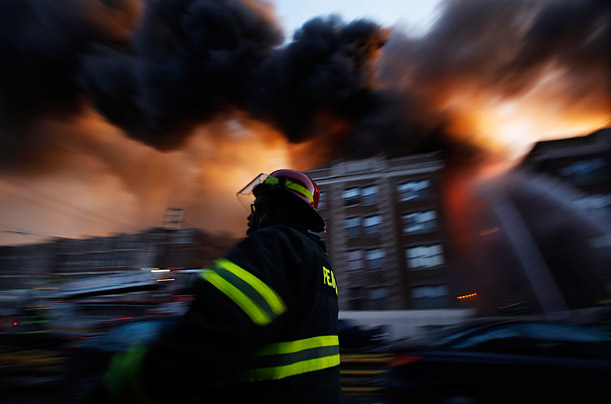 Firefighters battle a blaze in an apartment building in Philadelphia.