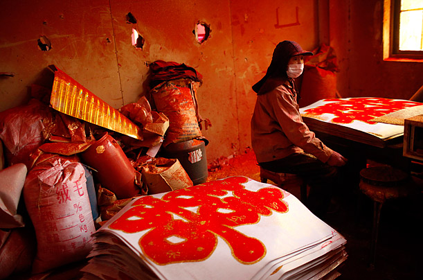 An employee works at a Chinese new year merchandising factory in Yiwu, Zhejiang province.  The Chinese New Year will begin on February 3, 2011, and according to the Lunar calendar, it