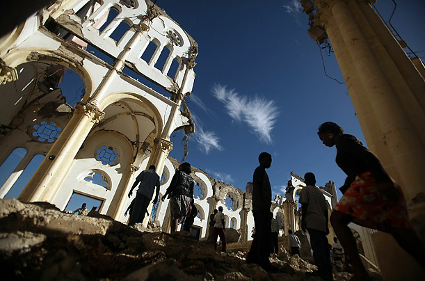 Haitians attend Mass at the destroyed Port-au-Prince cathedral.  Today marks the one-year anniversary of the 7.0 earthquake which killed over 200,000 people.